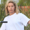 Riding her bike / Filming a video